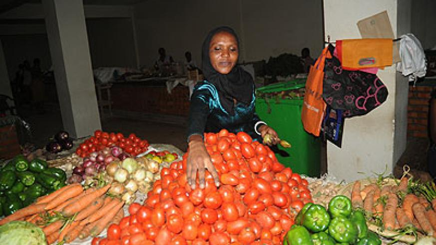 A woman trader at a  vegetable stall. More women are acquiring loans to do business.