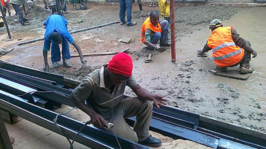Workers doing repairs at the market yesterday. The works are expected to be completed in April.  The New Times / Peterson Tumwebaze .