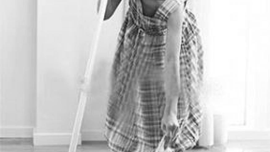 A young girl sweeping the house; a little help is always needed. Net photo.