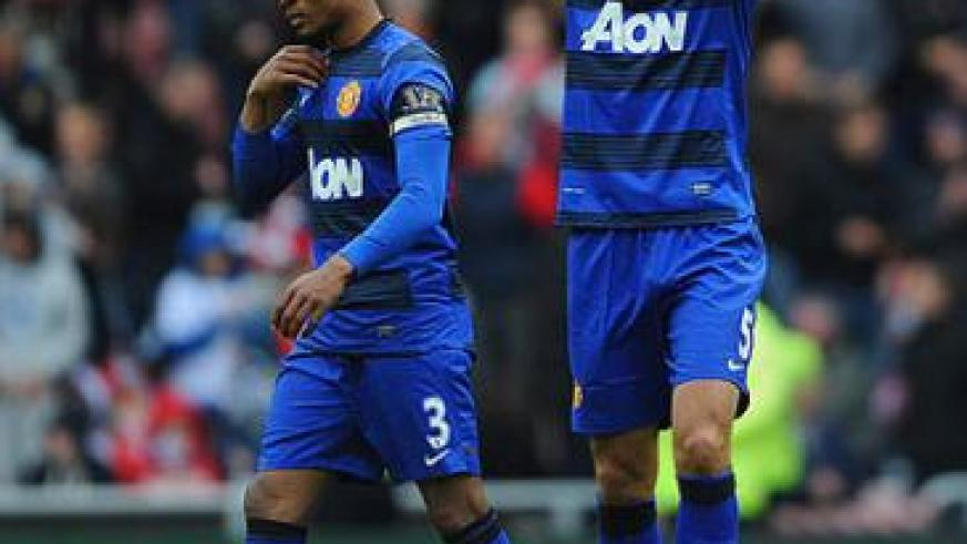 Manchester United Ferdinand and Evra leave the Sunderland ground last season disapointed after missing out on the title. Net photo.