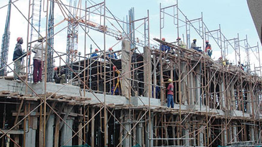 Men at work. Contractors can now focus on work as the burden of ensuring VAT on the jobs they get is now the responsibility of government bodies, according to the new public procurement tax law. The New Times / File photo