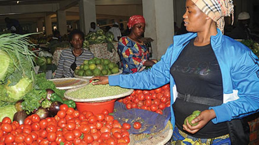 Tomotoes now cost Rwf1,100, while bananas will set you back by Rwf200. The New Times / Peterson Tumwebaze