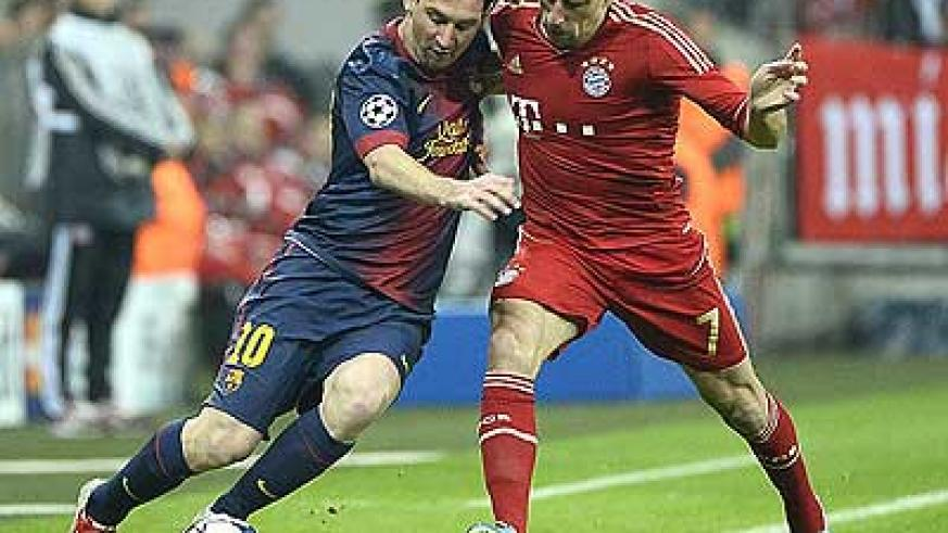 Barcelona's Lionel Messi and Bayern Munich's Franck in the first leg in Germany. Net photo.