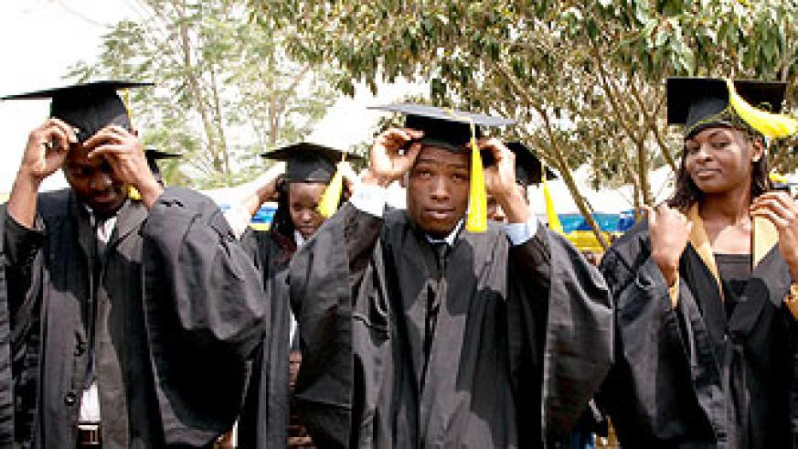 Kigali Institute of Management graduands adjust their mortarboards . Education Times/ Timothy Kisambira
