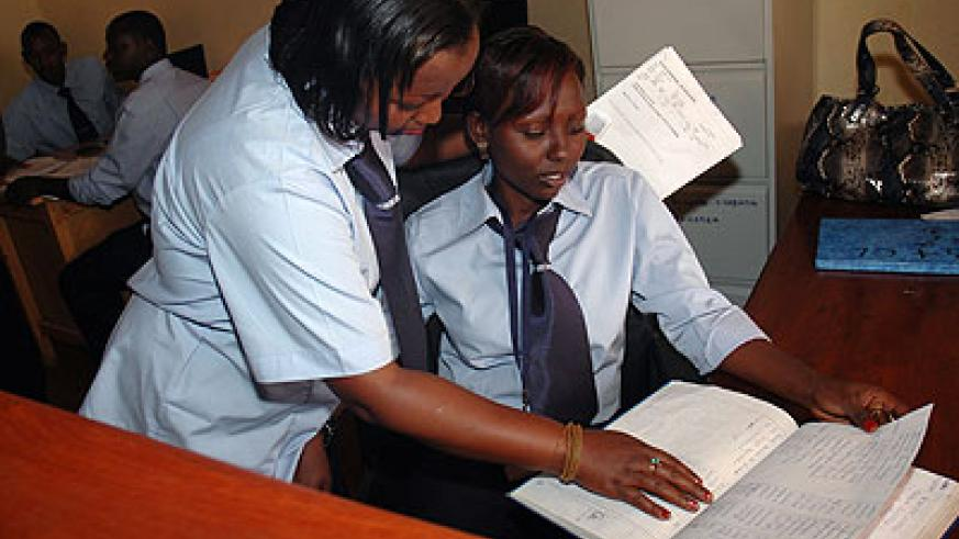 Workers consult each other. It is advisable for new employees to ask whenever they are not sure of what to do. The New Times / File