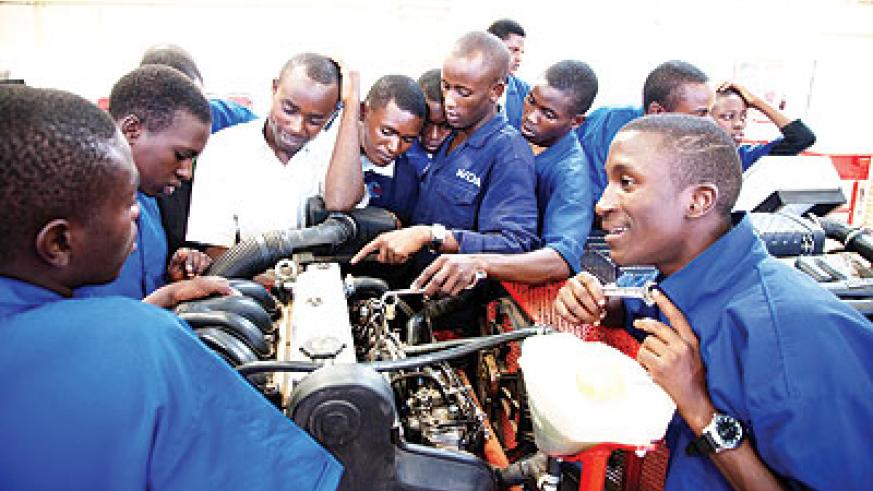 Students training to become mechanics.  The New Times/ Timothy Kisambira