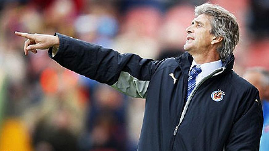 Pellegrini will take over from Mancini as Man City manager. Net photo.