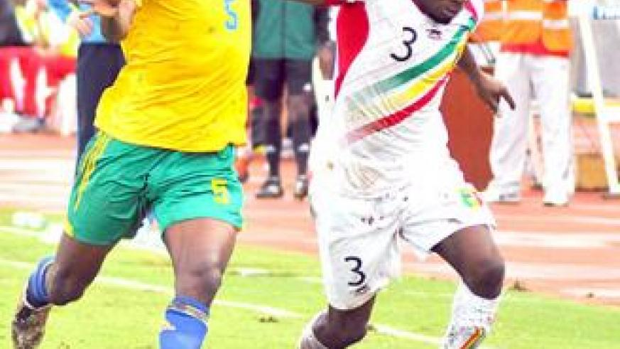 Meddy Kagere battles with Mali's full back Adama Tamboura during the last qualifier at Amahoro stadium. The two teams faceoff again on Sunday in Bamako.  Saturday Sport / Plaisir Muzogeye.