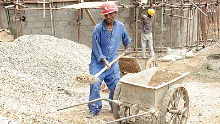 Workers at a construction site. The 25% imposed on building materials in the 2013/14 budget will make it hard for people to acquire homes or rent decent houses, according sector experts. The New Times / Timothy Kisambira