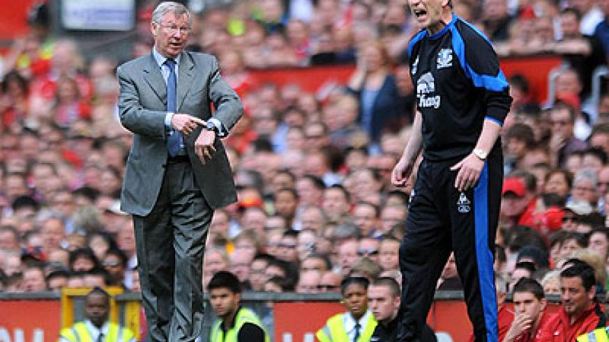 Former manager Ferguson is contemplating staying away from David Moyes's first run of matches at Manchester United.   Net photo.