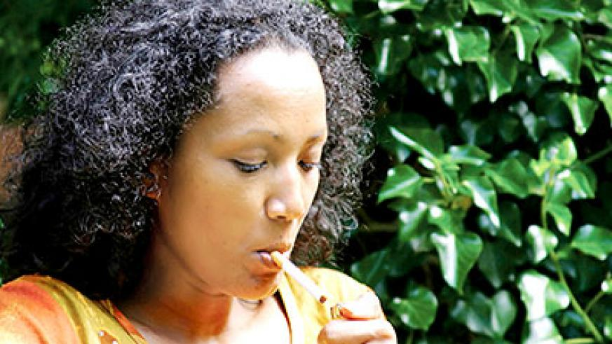 A woman lights a cigarette. Researchers have showed that smoking reduces the chances of a woman conceiving, with physicians urging that smokers must stop the act at least two months from starting to try conceiving.Net photo.