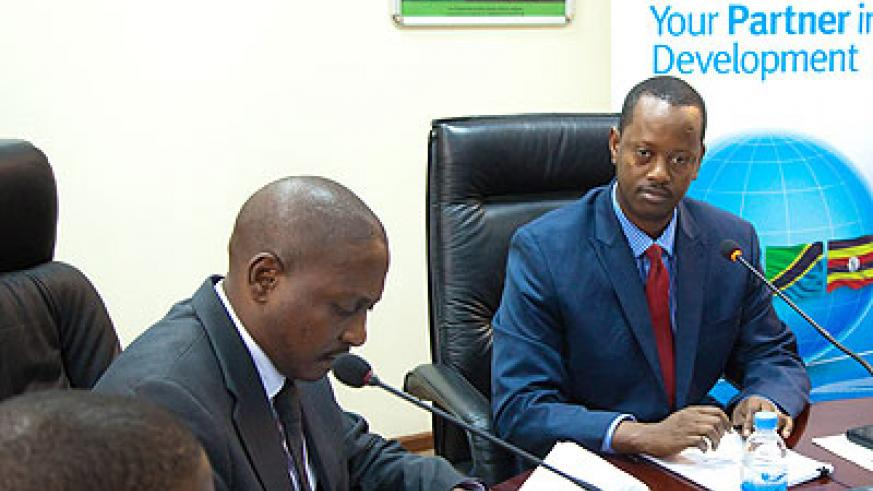 Duncan Mwesigye (left), the EADB Uganda country manager and former BRD boss Jack Kayonga sign the Rwf6.5b loan deal last week. The New Times / File