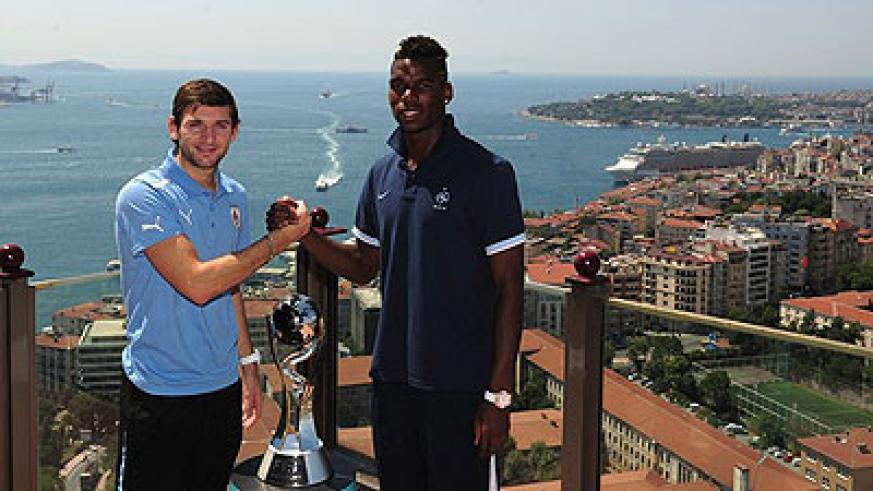 France's Paul Pogba and Uruguay's Lucna Digne. The pair face-off tonight in a thrilling final.  Net photo.