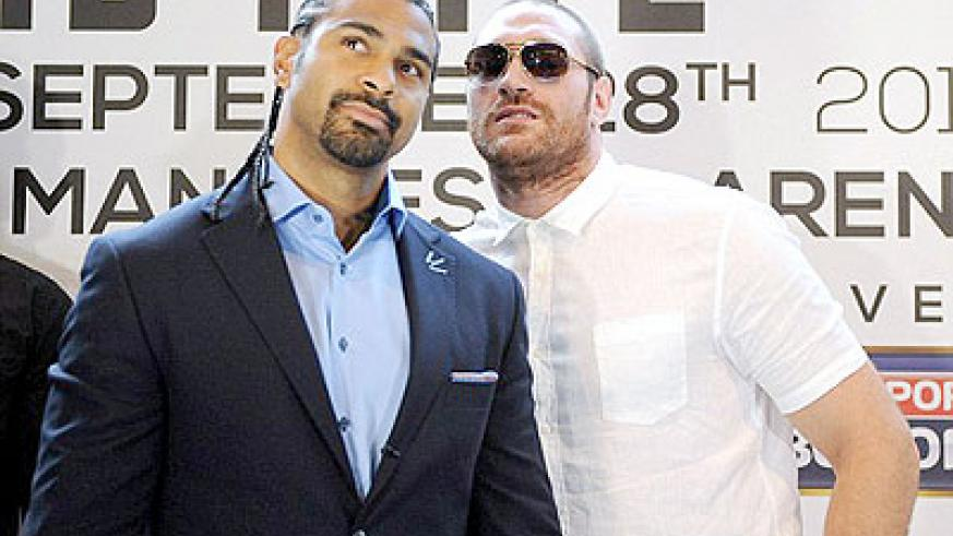 Head to head- David Haye and Tyson Fury come face to face to announce their heavyweight fight in September.  Net photo.