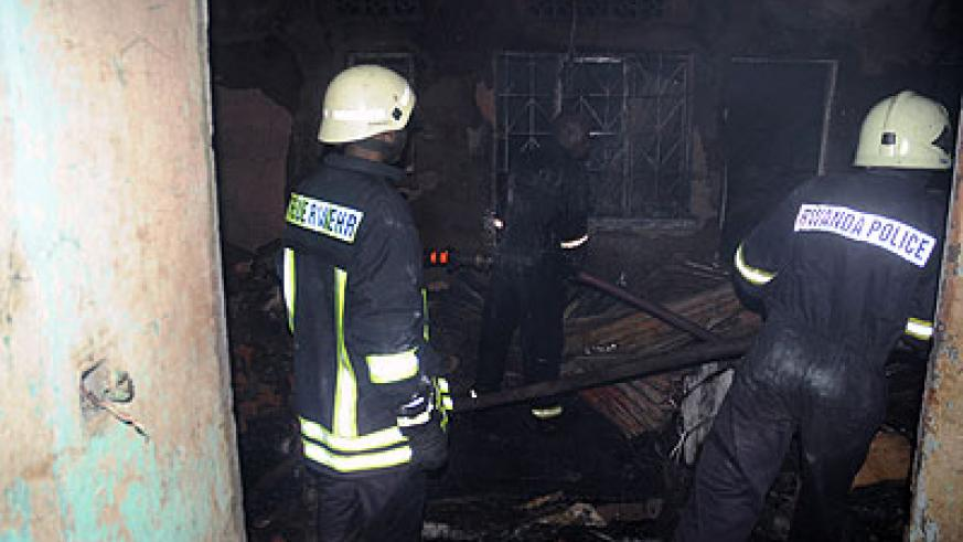 Police firemen putting out a fire Quartier Matheus, where businesses were gutted by fire on Saturday . The New Times / John Mbanda