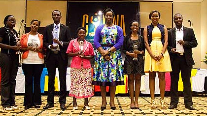 Mrs Kagame together with the seven CYRWA winners at the awards ceremony on Tuesday. The New Times/Timothy Kisambira