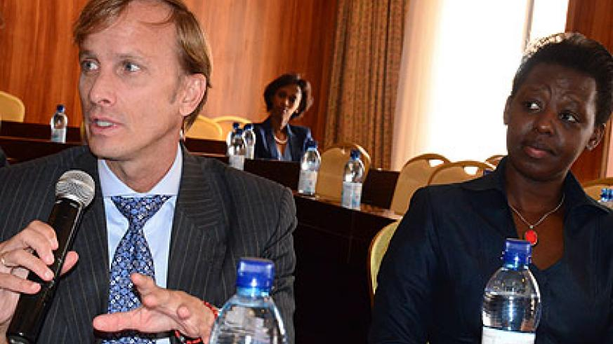 Global Fund's Mark Dybul and Dr Anita Asiimwe, the State Minister for Primary and Public Healthcare during the meeting yesterday. The New Times/ Irene Nayebare