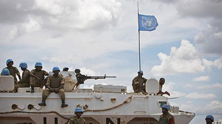 Soldiers serving with the UNIMIS sitting on a tank at Abyei town.Xinhua photo.