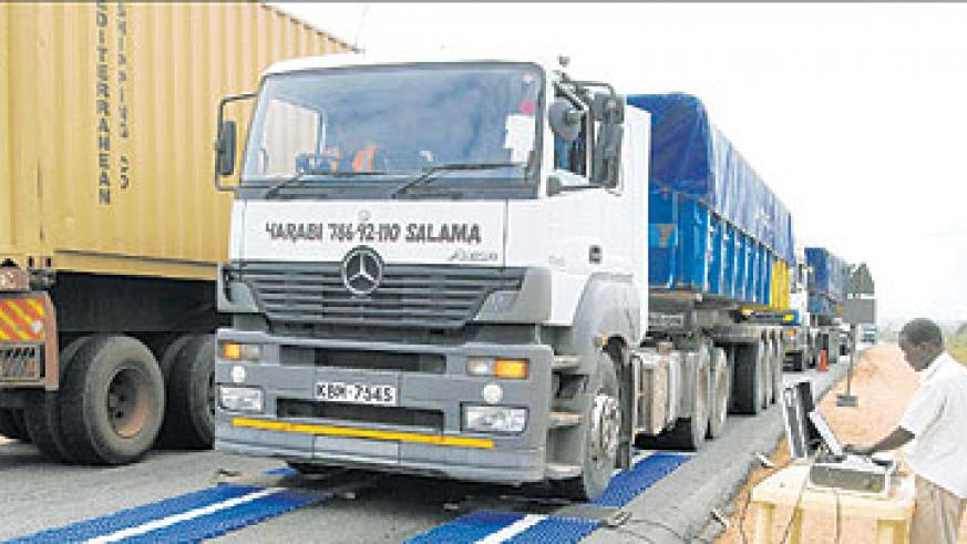 A cargo truck at a weighbridge. The roads agency is to reintroduce the bridges to check overloading of trucks. The New Times / File photo