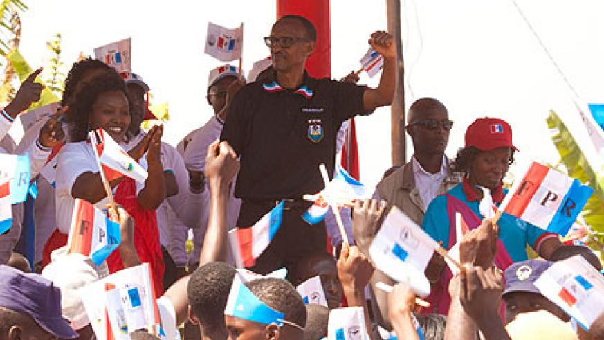 Paul Kagame, the RPF party chairman, is joined by party supporters at the rally in Kamonyi yesterday. The New Times/Timothy Kisambira.