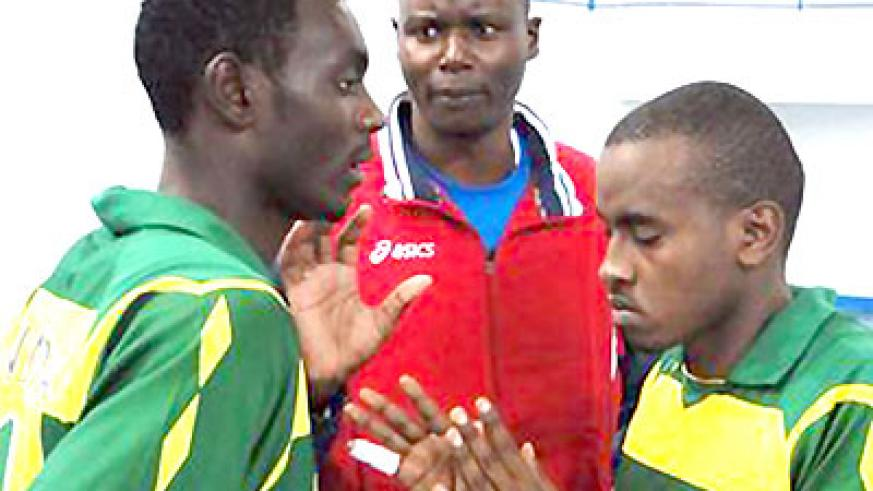 Rwanda junior volleyball national head coach Paul Bitok (C) giving instructions to his players. Times Sport/Courtesy