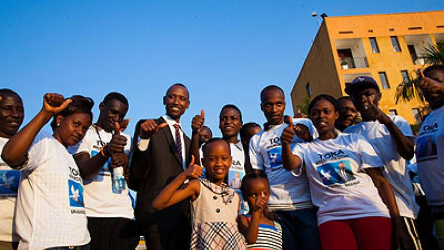 Mwenedata  poses with his family and supporters on Wednesday.   The New Times/ Timothy Kisambira.