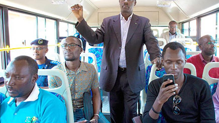 City of Kigali mayor Fidele Ndayisaba and other passengers during the launch of the KBS designated route covering Kabuga, Mulindi, Remera and Kanombe yesterday. Saturday Times/Timo....