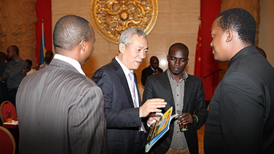 Ambassador Shen interacts with some of the former beneficiaries of the Chinese government  scholarships.  The New Times/Ivan Ngoboka.