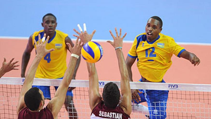 Rwanda's skipper Aimable Mutuyimana (right) spikes against Venezuela's block. Times Sport / Courtesy.