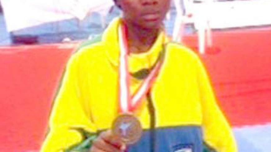 Aisha Umuhoza shows off her medal in Tunis. Times Sport / Courtesy.