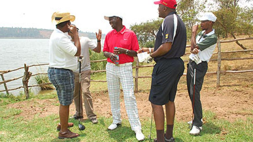Members of the local golf fraternity share a light moment.