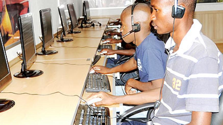 Youth at an Internet hub in Kigali. The EAC information and communication technology treaty will ensure ICT services are at citizens' disposal in the Common Market.  The New Times/ File