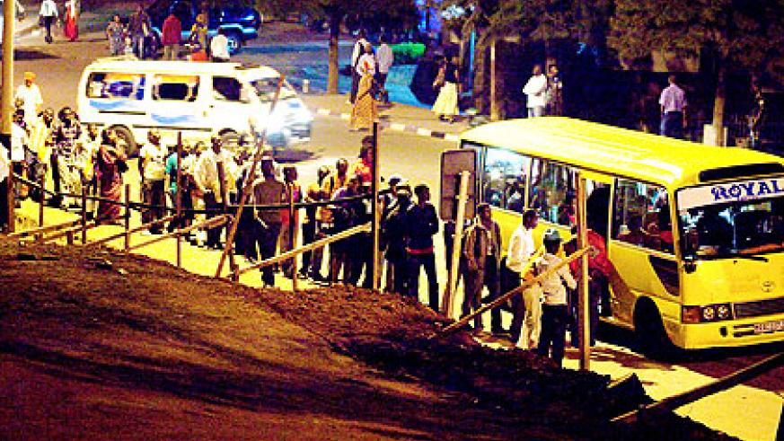 City commuters queue for buses during peak hours yesterday. The New Times/T. Kisambira