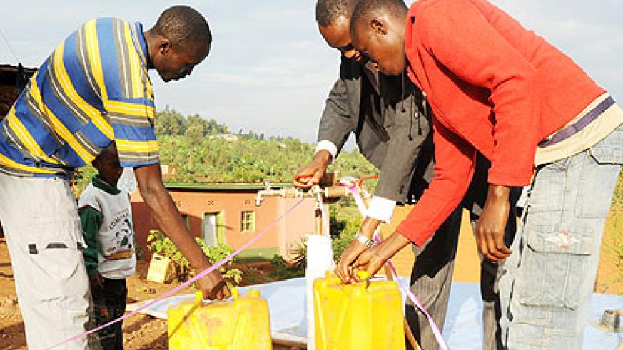 Kigali residents buy water stored in a 'bladder' reservoir. The New Times/File