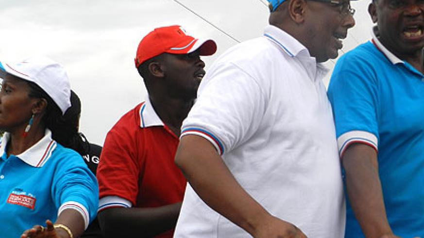 Rukumbura (in white t-shirt) and other party candidates at a rally. The New Times/ Rwembeho