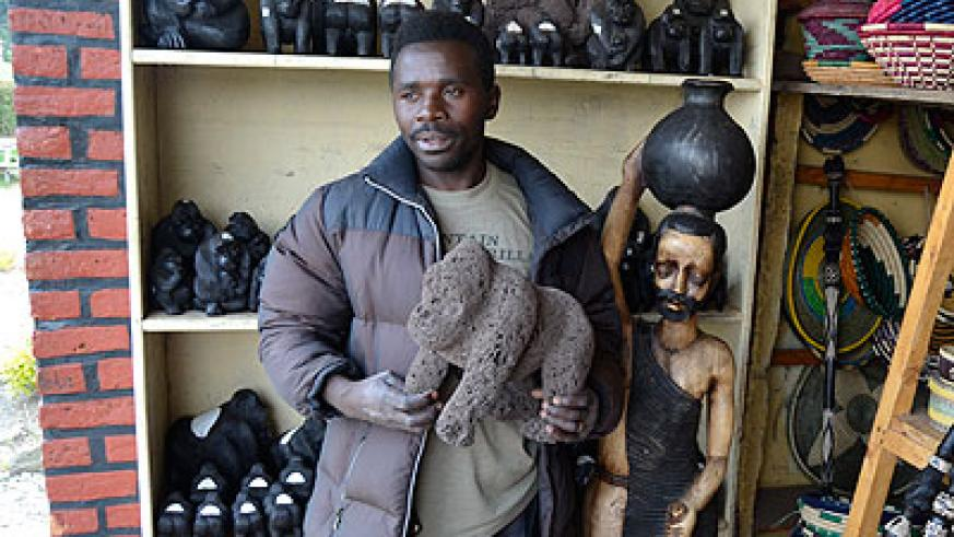 Leonidas Hatumimana stands in a display room for art products their cooperative members make. The New Times/Jean d'Amour Mbonyinshuti