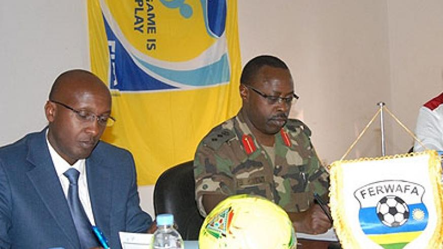 Ferwafa chairman  Ntagungira and Head of Kanombe Military Hospital Col Dr Ben Karenzi signing the pact on Wednesday. Times Sport/Courtesy.