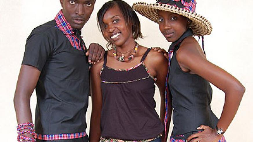 Colombe Ituze Ndutiye (C) poses for a photo with local models.  The New Times / Courtesy.