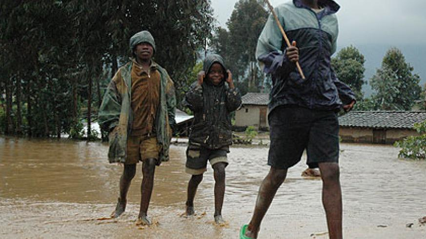 Children play after heavy rains in the Northern Province. Rwanda, like other countries world over, is experiencing floods and other natural catastrophes due to climate change. The ....