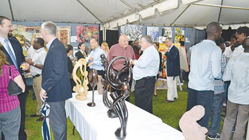 Art lovers braved the heavy rain to attend the art exhibition held at U.S Deputy Chief of Mission's residence in Kiyovu.