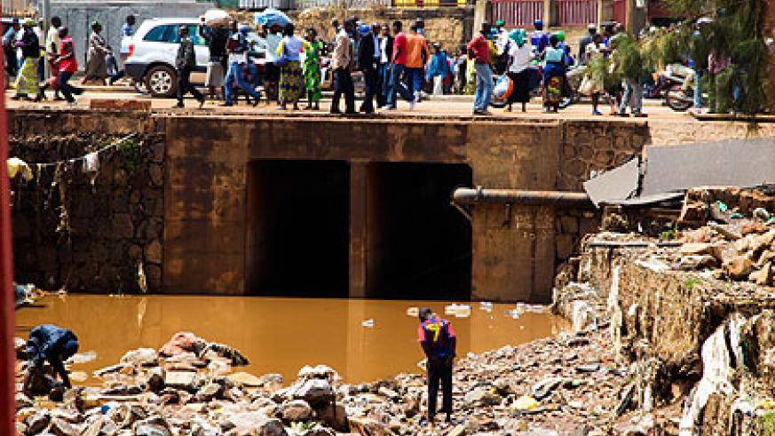 A clogged drainage channel in Nyabugogo, Kigali, blamed for another round of heavy  flooding in the commercial area on Monday. Nyarugenge authorities have been faulted for not clea....