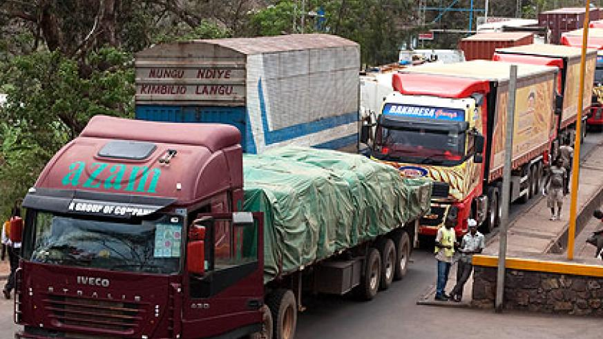Trucks at the Rusumo border post. A reduction of $348 will have a huge impact on Rwandan business, according to experts. The New Times/Timothy Kisambira
