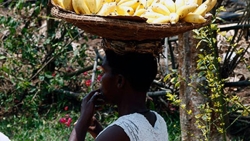 A woman vends bananas in Kigali.  There is an estimated 7,000 street vendors in Kigali.  The New Times/ John Mbanda