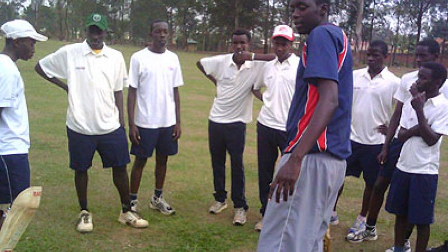 The U-17 boys team coach giving technical tips to his youthful squad. The New Times / Courtesy.