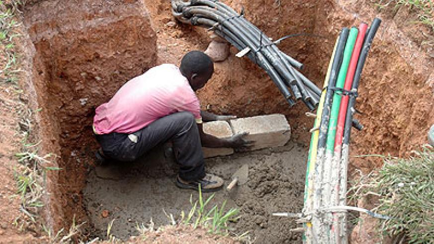 A man lays a fibre optic cable. Rwanda is among a few countries in Africa set to roll-out a high-speed 4G broadband network that delivers download speed of up to 100 Megabytes per ....