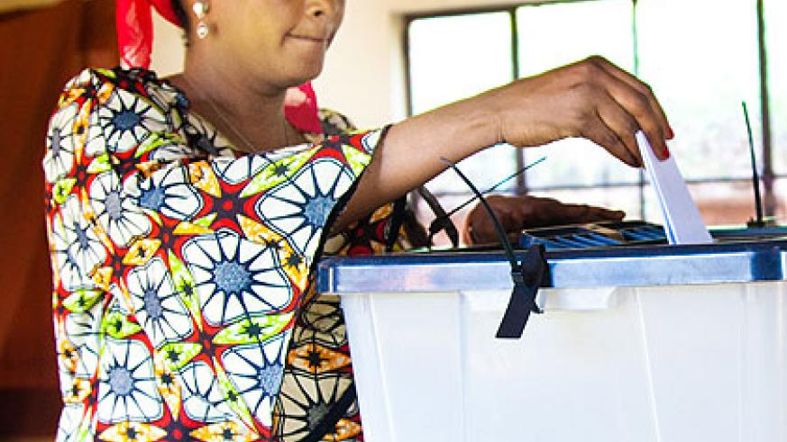 A woman casts her ballot during the electoral college voting for women's representatives to the Chamber of Deputies on Tuesday. Women will occupy 63 per cent of the seats in the ....