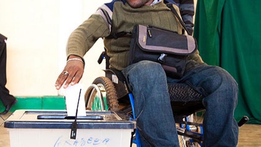 A disabled person casting his ballot yesterday. The New Times/Timothy Kisambira