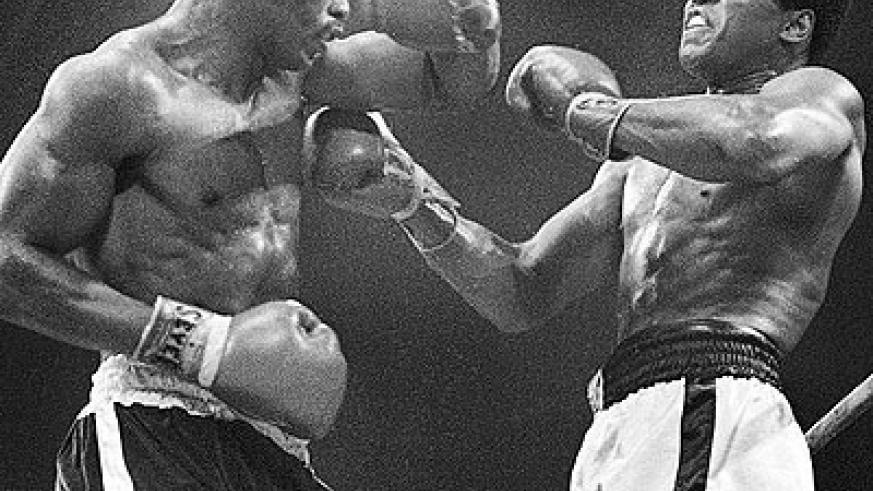 Ali (right) winces as Norton catches him with a left hook to the head in the '73 re-match. Net photo