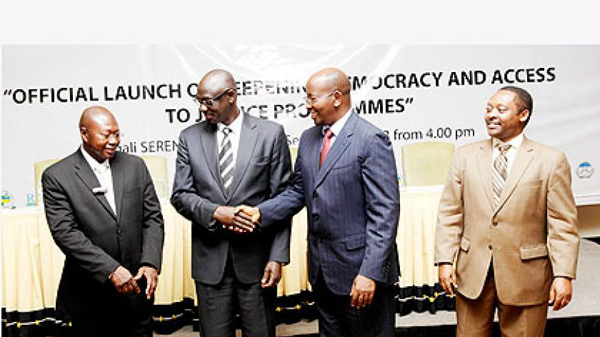 L-R; Manneh, Busingye, Musoni and Shyaka at the launch of 'deepening democracy' in Kigali yesterday. The New Times/ John Mbanda.