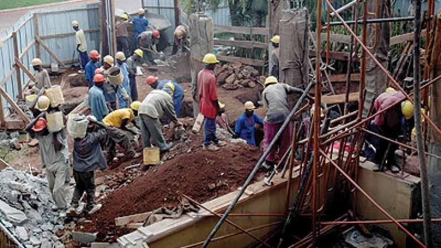 Workers at a building site. The Government is to issue construction policy to streamline the sector. The New Times /File Photo